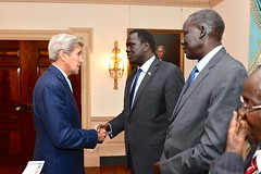 U.S. Secretary of State John Kerry greets South Sudanese Vice President James Wani Igga before their meeting at the U.S. Department of State in Washington, D.C., on October 7, 2015. [State Department photo/ Public Domain]