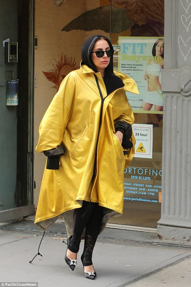 oversized-yellow-raincoat-black-leggings-black-headscarf