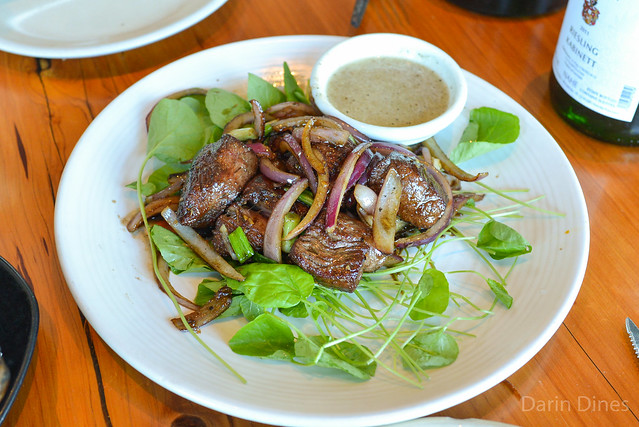 grass-fed estancia shaking beef, 8 oz. cubed filet mignon, sausalito watercress, red onion, lime sauce