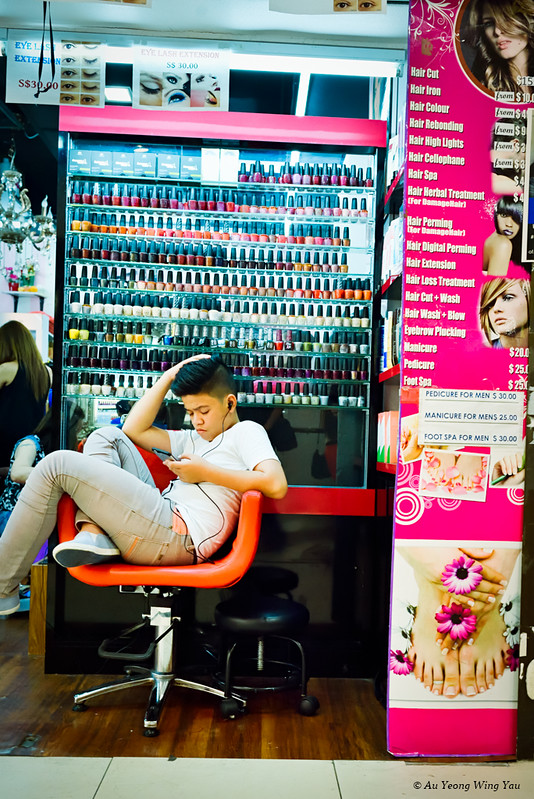 Young Man Waiting At The Hair Saloon