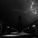24. November 2015 - 13:29 - B&W of the Nelson-Mandela-Bridge in Ilmenau (Germany) with a single lightning in the background. A heavy summer thunderstorm sweeps across the bridge. So scary!