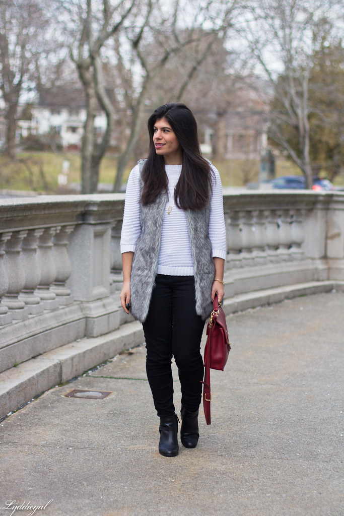 white sweater, black jeans, grey fur vest.jpg
