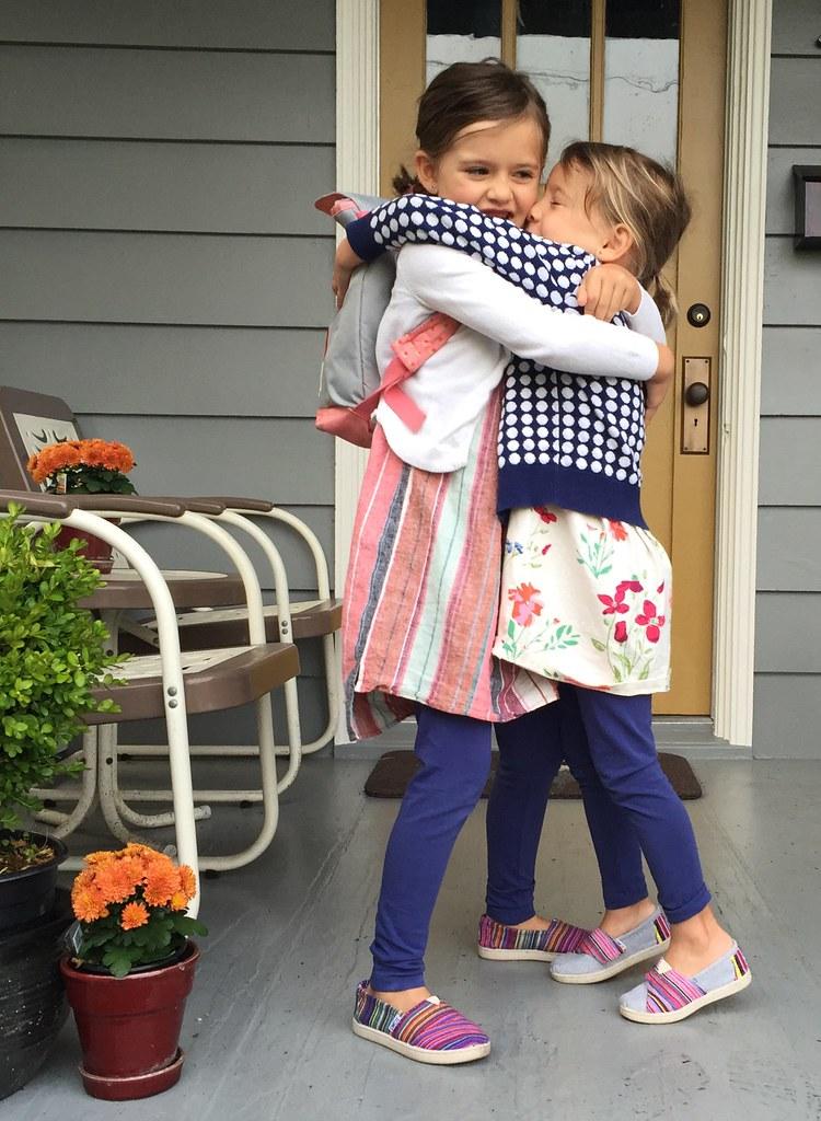 sisters hugs