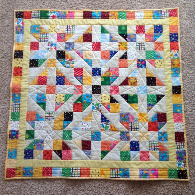 """Dots, Hearts and Stars II finished, """"fraternal twin"""" to the first baby quilt, from all the same scrap and background fabric. Different border, binding, backing and a few different quilting lines."""