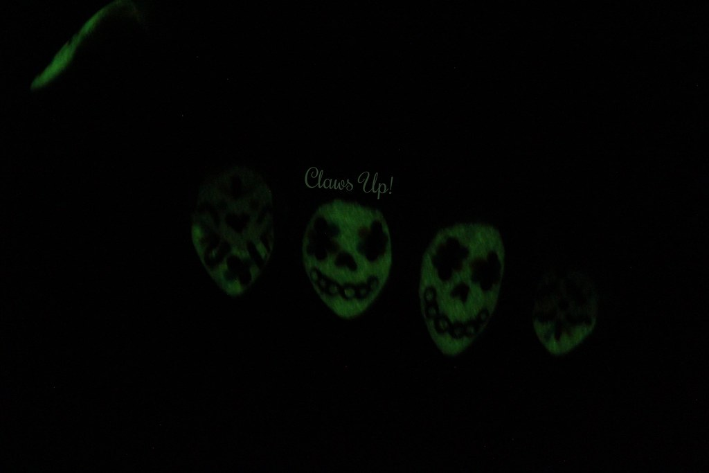 Glow in the dark sugar skull Day of the Dead nail art