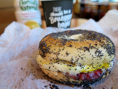 Back Bay breakfast bagel with OJ and coconut coffe…