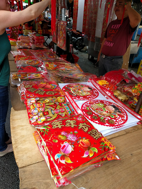 choosing a Chinese lantern to bring home