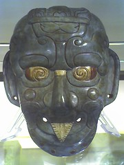 helmet(0.0), hockey protective equipment(0.0), personal protective equipment(0.0), clothing(0.0), goaltender mask(0.0), costume(0.0), headgear(0.0), masque(1.0), carving(1.0), sculpture(1.0), head(1.0), mask(1.0),