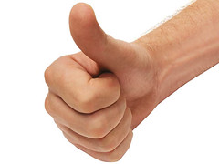 photo of a hand with thumb up against a white background
