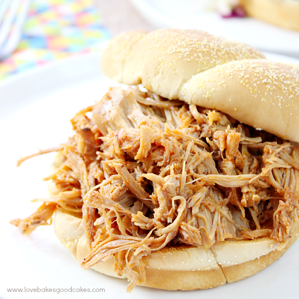 This Chipotle Pulled Pork Sandwiches with Mexican-Style Coleslaw recipe is a quick and easy meal solutions that doesn't sacrifice flavor. Let your slow cooker do the work! Classic American BBQ with a Latin flair!  #VivaLaMorena  #ad
