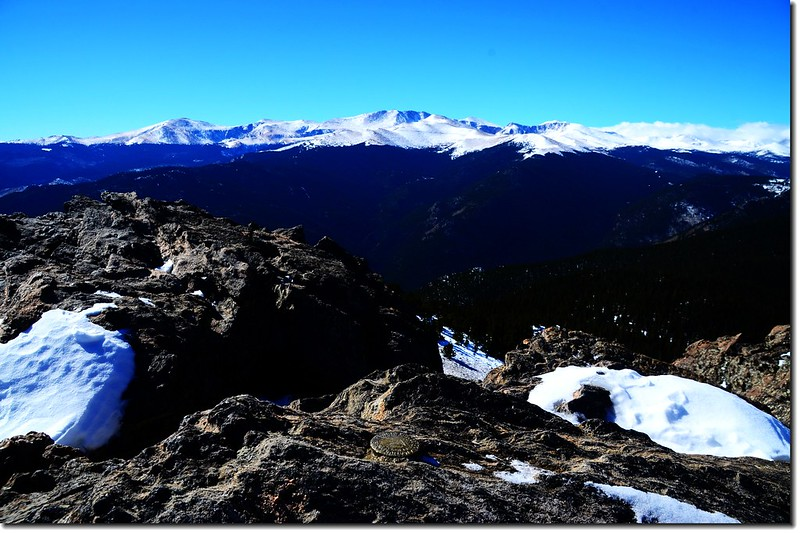 Chief Mountain Summit Marker, in the background are Mount Evans Massif