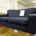 Large two seater navy fabric sofa