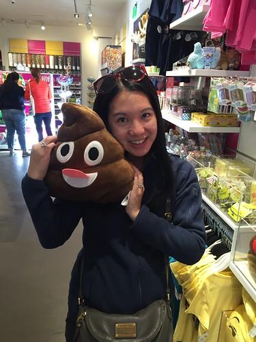 Mei and the poop emoji plushy.