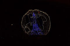 An image of the Eiffel Tower is contained with an illuminated globe outside LeBourget Airport in Paris, France, on November 29, 2015, as President Barack Obama, U.S. Secretary of State John Kerry, and other government leaders arrive to attend the COP-21 climate change conference. [State Department photo/ Public Domain]