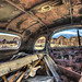 Bodie, California view through an old car full of junk. by Randall R. Howard