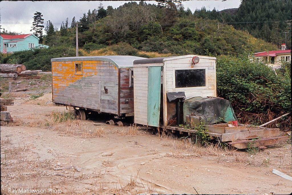 Abandoned railcars in flood debris Feb 1971