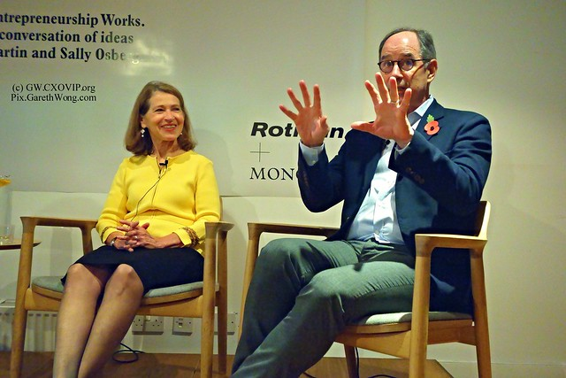Sally Osberg laughing with animated Roger L Martin from RAW _DSC5231 at Monocle office, Getting Beyond Better book launch