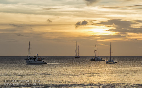 Sunset with yachts and catamarans at Nai Harn beach, Phuket, Thailand | by Phuketian.S
