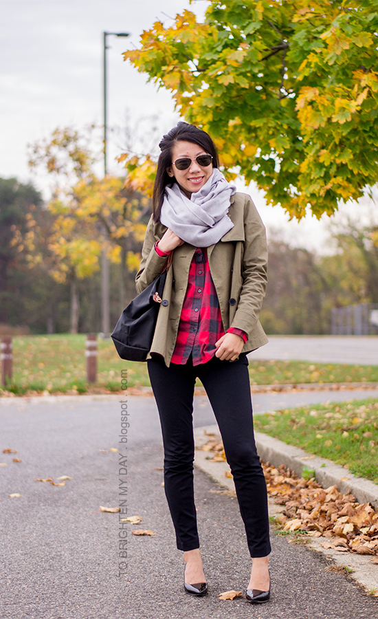 gray scarf, olive green jacket, red buffalo check shirt, black pants, black patent pumps