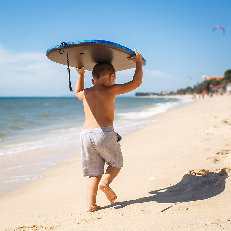 4 year old boy with a surfboard