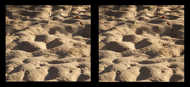 Faces in the sandpit