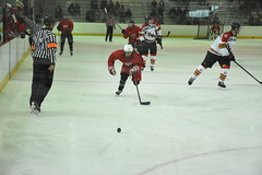 Taylor Holze goes for the loose puck
