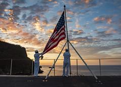 Sailors perform evening colors aboard USS Carl Vinson.