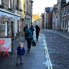 My travelling companion takes on the windy streets of St Andrews, Scotland.