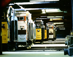 Commuter trains lined up in C&NW Madison Street depot train shed on 3-7-1981