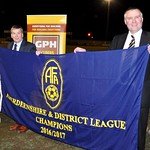 The championship Flag presented by Aberdeenshire FA president Mike Macaulay to Chairman George Clark