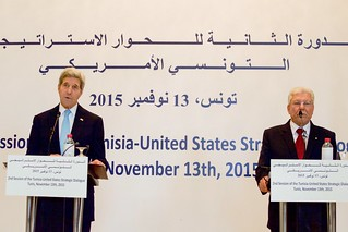 Secretary Kerry Stands with with Foreign Minister Baccouche at a Joint News Conference at the Ministry of Foreign Affairs in Tunis