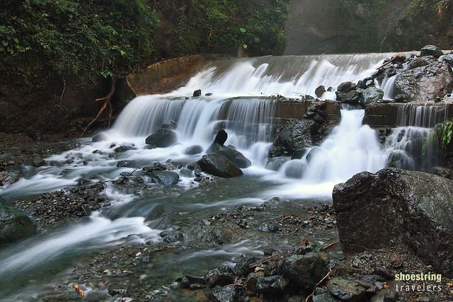water flowing from concrete weir at Ditumabo Falls