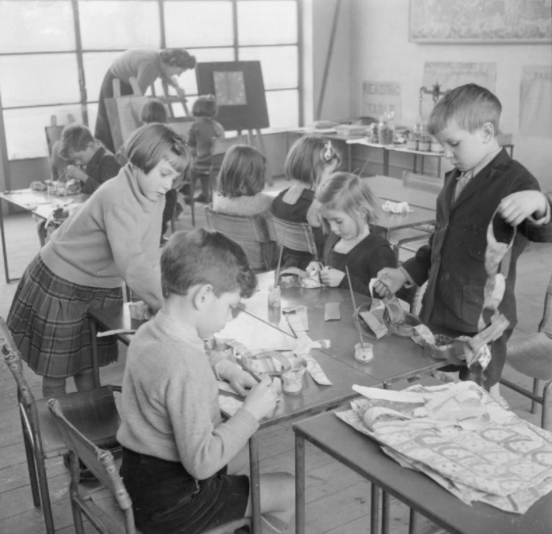 A group of young children at Junior School design and make their own Christmas decorations in Cambridgeshire, England, 1944