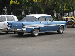chevrolet(0.0), coupã©(0.0), automobile(1.0), automotive exterior(1.0), 1957 chevrolet(1.0), vehicle(1.0), compact car(1.0), sedan(1.0), land vehicle(1.0), luxury vehicle(1.0),