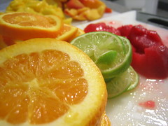 garnish(0.0), plant(0.0), candied fruit(0.0), produce(0.0), dish(0.0), dessert(0.0), clementine(1.0), citrus(1.0), orange(1.0), fruit(1.0), food(1.0), cuisine(1.0),