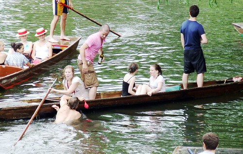 People hanging out on punt boats.