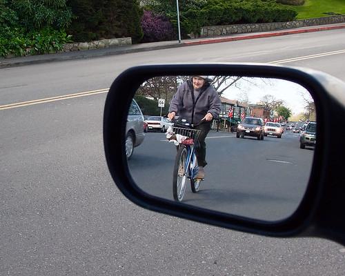 Cyclist in rear view mirror