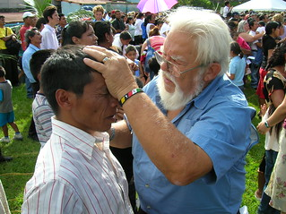 EJ prays for a man at the Sunday afternoon crusade