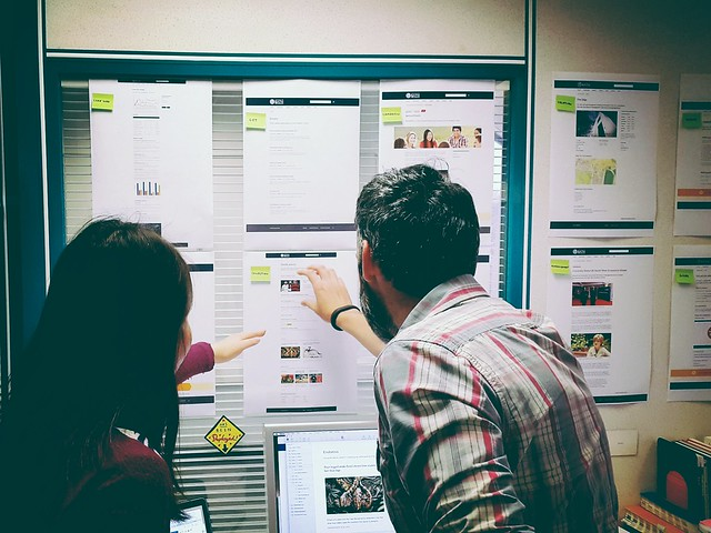 People discussing design mock-ups