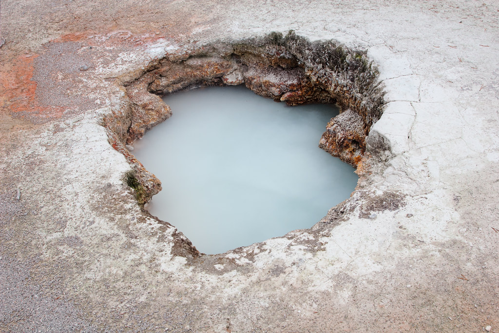 A geothermal feature filled with water in Yellowstone National Park