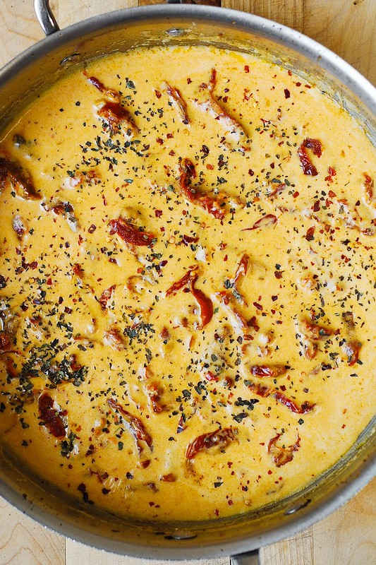 making creamy sauce with sun-dried tomatoes, basil, garlic, and red crushed pepper