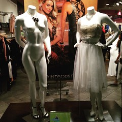The mannequin on the right is selling a dress, the mannequin on the left is selling jewelry...I think.