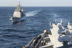 USS Chancellorsville (CG 62) prepares to conduct a refueling at sea with USS Ronald Reagan (CVN 76) while operating off the Korean Peninsula Oct. 25. (U.S. Navy/MCSN Sara B. Sexton)