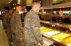 Senior leaders throughout the Vicenza Military Community serve traditional Thanksgiving fare to Soldiers, civilians and Families, Nov. 24 at the Caserma Del Din dining facility, Vicenza, Italy. The dining facility opened at 11 a.m. and remained open until