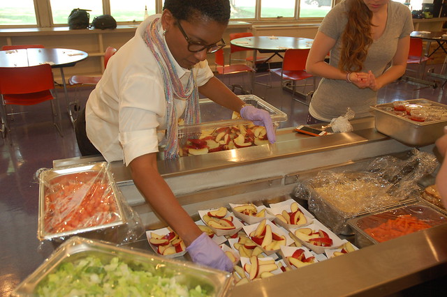 Dr. Lynn Todman serving lunch to students