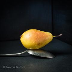 Pear on table spoon