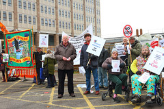 Workers and disabled people protesting outside Norfolk County Hall against Norfolk County Council cuts to services A3 but thinner