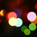 Defocused light effects holiday background. by nakshfan