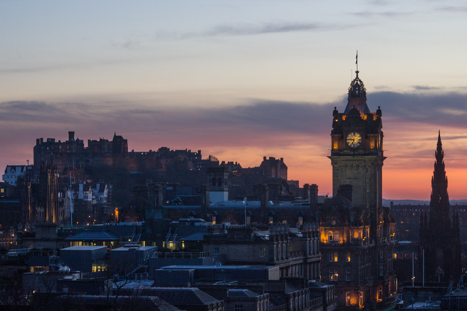 Purple, pink and orange sunset from Calton Hill over Edinburgh Castle and The Balmoral