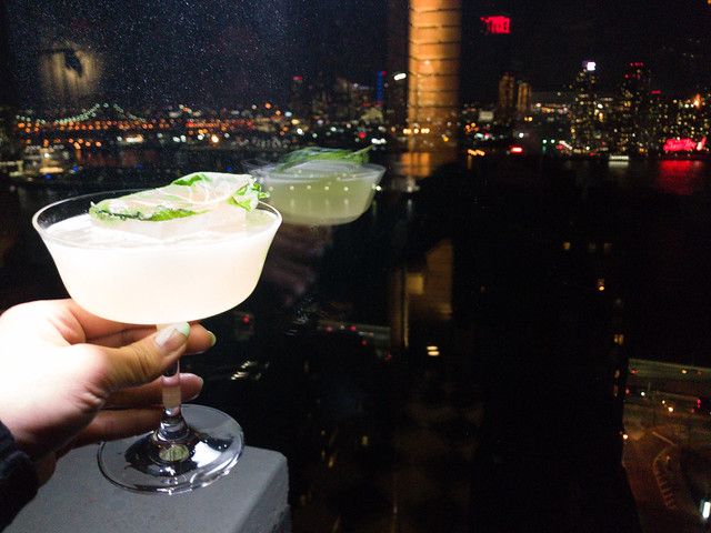 Far East Side cocktail with a lovely night view